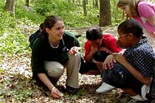 Teacher and students, outdoors